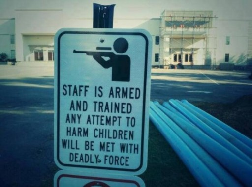 Armed-Teacher-Sign-555x414